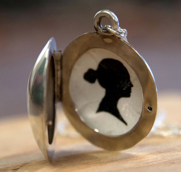 Photo of a metal locket created by Zach Andersen.