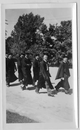 Erickson walking in cap and gown
