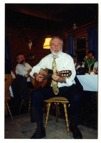 Barre Toelken playing a guitar and singing, Salzburg, Austria, 2001 (1 of 2).