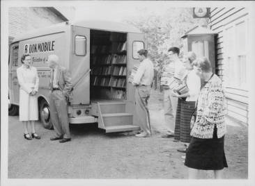 Loading the Missoula Public Library Bookmobile with books (ca. 1957)