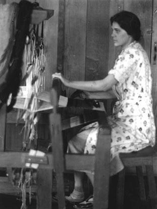 Jane Chase, spinner and weaver, at the loom