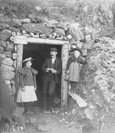 Mr. Hartshorn, Hazel Hartshorn, and another child at the entrance of a mine.