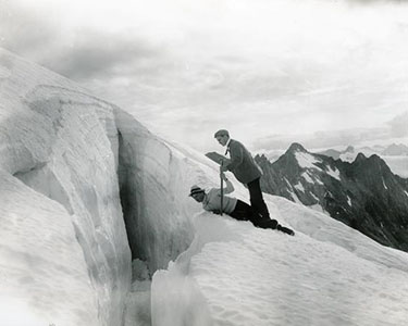 Two men at a glacial crevasse