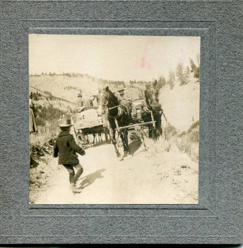 Men in wagons pulled by horses, young boy on foot (unidentified)