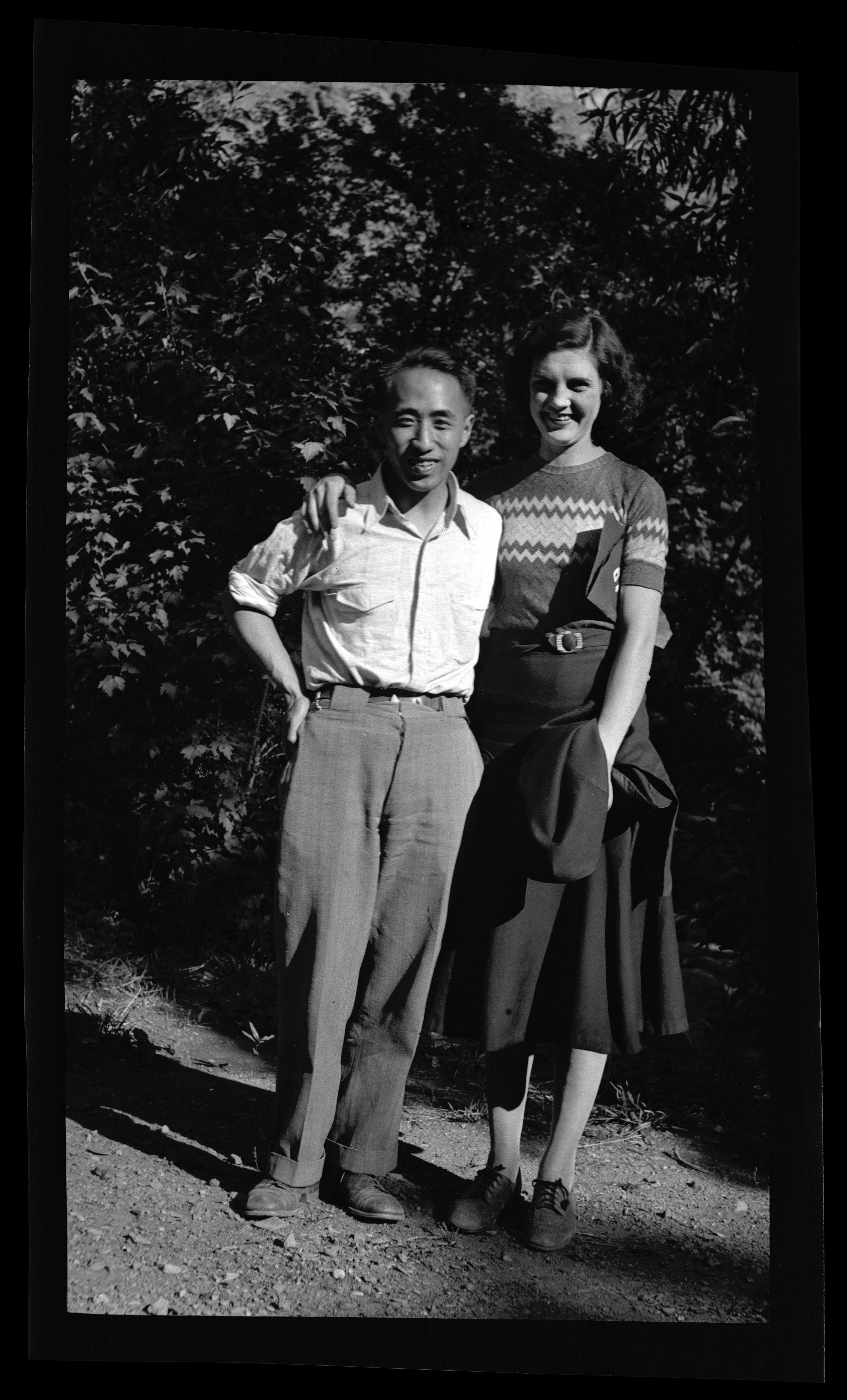 Snapshot of man and woman posing, trees in background, 1932. Individuals from Provo Internation Society of Christian Endeavor retreat
