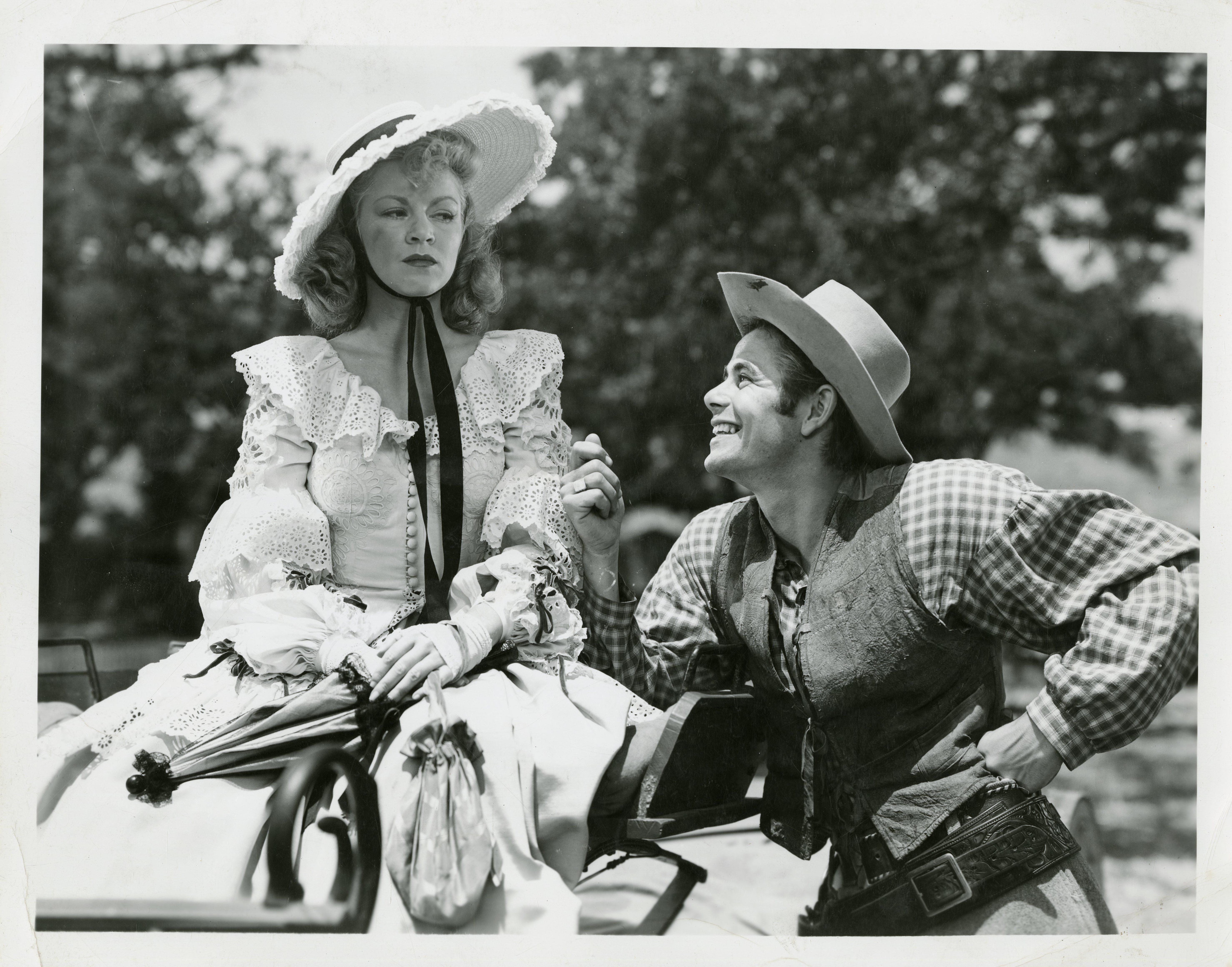Claire Trever and Glen Ford in a scene from the Columbia production, Texas.