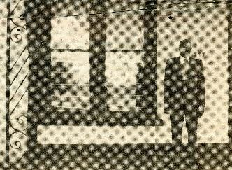 Picture of a man standing to the right of a window