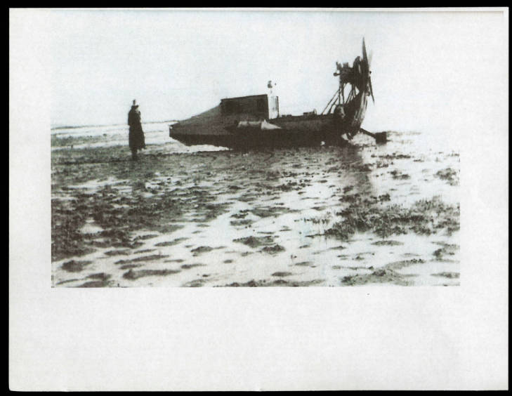 Duplicate of a photograph of an airboat owned by Christopher Layton, given to Craig Dangerfield by Dave Wooley. Dangerfield believes this boat is one of the very first airboats on the Great Salt Lake (in Utah), circa 1930s. Most airboats in Utah showed up on the Great Salt Lake after WWII around 1945 with all the surplus plane part. However, this boat appears to be earlier as the propeller in the pictured boat is behind the motor, in the rear of the boat. It is a pusher style with a mud rutter in the back of the motor and looks like it was steered by a manual rutter. The tractor style boat that came later after WW II (not pictured) had the propeller in front of the motor, closer to the operator.